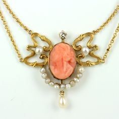 Art Nouveau coral cameo and pearl pendant.  If you love this check out Renaissance Fine Jewelry in Vermont.