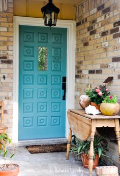 Remodelaholic | Home Sweet Home on a Budget: Porches, soft spot for retro doors…and for turquoise. Read more at http://www.remodelaholic.com/home-sweet-home-on-a-budget-porches-patios-and-entryways-liPatios, and Entryways LINKUP