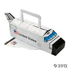 """Space Shuttle Treat Boxes. Get ready to blast off into an awesome outer space birthday party with our Space Shuttle Treat Boxes! Fill these party favor boxes with treats and toys for an astronaut birthday party that's out of this world. Paper. 10 3/4"""" x 3"""" Simple assembly required. © OTC"""
