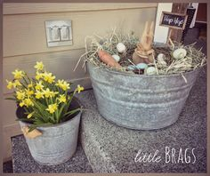 flower arrangements in old galvinite buckets | like this old galvanized wash tub, it makes a perfect Easter nest