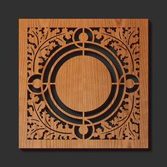 Robert's Skylight trivet; Functional art for wall or table - this cherry wood finished trivet has precision laser cut detail and cushioned feet. This design from the vestibule skylight of the C.E. Roberts House has a pattern of circles framed by stylized oak leaves.