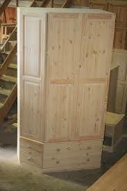 Custom made corner wardrobe: http://woodenwardrobe.co.uk/