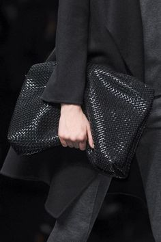 over sized black clutch bag, love the texture of the leather on this bag