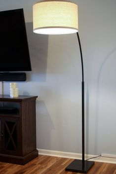 The Logan LED Floor Lamp adds upscale sophistication to a variety of interior design schemes such as urban, contemporary, mid century modern, minimalist, traditional, and industrial styles. It will add a touch of elegance to your home or office with its neutral linen lamp shade that perfectly complements the black or antique brass pole and black marble base. #livingroomlamp #readingnook #floorlamp #ledlamp #livingroomdecor #contemporarylamp Elegant Living Room, Boho Living Room, Living Room Modern, Rooms Home Decor, Bedroom Decor, Interior Design Living Room, Living Room Designs, Bright Floor Lamp, Linen Lamp Shades