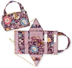 It's a needlework case/purse. I want to make one of these.