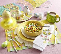 Whimsical, Easter inspired table scape from Pier 1. I love the fancy charger and decorative table runner!