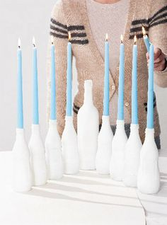Happy Day of Hanukkah. How fab is the DIY spray painted bottle Menorah? Just love the white painted glass bottles with the gorg blue! Hanukkah Crafts, Hanukkah Decorations, Hanukkah Menorah, Christmas Hanukkah, Happy Hanukkah, Hanukkah Candles, Hanukkah 2017, Jewish Hanukkah, Jewish Crafts