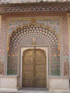 Jaipur City Palace, Jaipur, India.  This door is adorned with precious and semi precious stones!