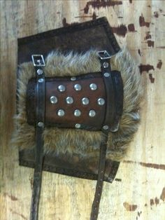 Fur and leather greaves and bracers                                                                                                                                                                                 More