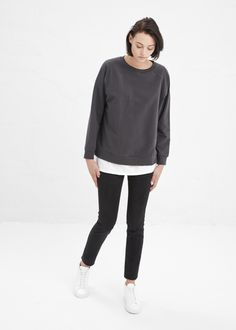 Oversized, heavyweight, long-sleeved T-shirt in a washed black cotton and spandex blend. Rounded neck. Machine wash cold, tumble dry low.