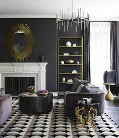Introducing gold as an accent color is an instant way to warm up a cool black and white space.