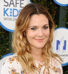 Barrymore's bohemian waves have a laidback, beachy vibe, but its her color, the perfect copper-blonde ombré, that we love the most about her look.   - ELLE.com