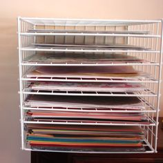 """Make Your Own Paper Storage Rack  My 12x12"""" cardstock/paper storage woes will soon be behind me. Three  cheers for this super simple how to with wired storage cubes and zip  ties!"""