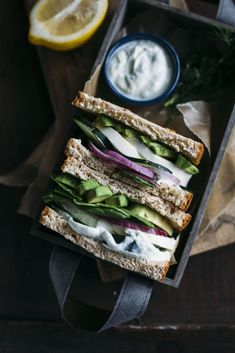 This Green Greek Goddess Sandwich is filled with vegetables, fresh mozzarella cheese and a simple homemade tzatziki sauce. Yum!