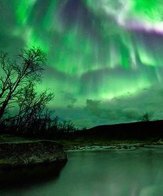 """09/30/2011 - A stream of charged particles from a massive solar storm gave Earth only a glancing blow, but it was still strong enough to provide skywatchers from New Zealand to Norway with """"unforgettable"""" displays of the aurora."""