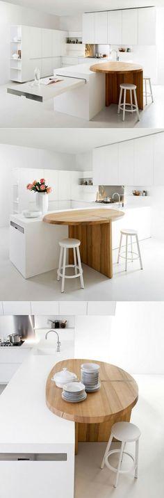 arbeitsplatte küche weiß ovaler tisch holztextur weiße küchenschränke