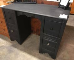 Redo / Upcycle Inspiration & Idea: mayte black paint (perhaps chalkboard paint) on desk or piece of wood furniture creating an antiqued look without a dated or dilapidated feel at all.  #redo #paint #upcycle #ideas #diy #desk #furniture #home #retro