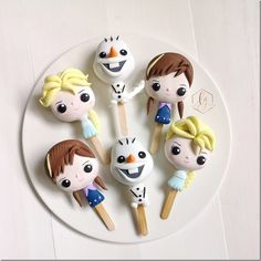 Fabulous Frozen Funko Pop Cakesicles made by Sweet Endings by Lulu. These adorable cakesicles are based on Funko Pops of Anna, Elsa, and Olaf.