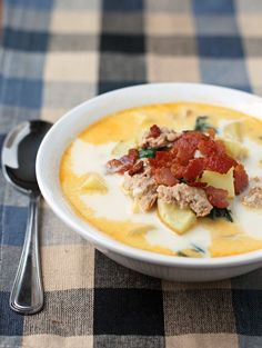 This lightened up Zuppa Toscana is an Olive Garden copycat that is filling, delicious and just 236 calories or 6 Weight Watchers points per serving! www.emilybites.com