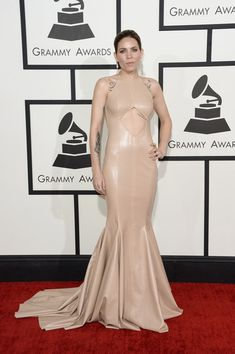 Leather Dress Lookbook: Skylar Grey wearing Michael Costello Leather Dress (5 of 7). Skylar Grey worked the Grammys red carpet in a nude Michael Costello leather gown with a belly-baring cutout and a mermaid silhouette.