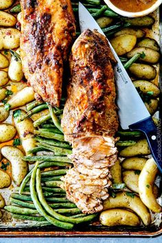 Sheet Pan Chili Dijon Pork Tenderloin with Green Beans and Potatoes all baked on ONE PAN! Tangy, sweet and spicy and SO melt in your mouth tender!