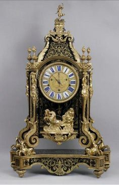 Moscow Kremlin Museums: - The Art of Restoration at the Moscow Kremlin Museums. Mantel clock  Paris, the XIXth century. Bronze, iron, wood; casting, inlay, enamel, gilding.  Received from the Palace property. Underwent restoration in 2008-2009. Restorer V. Vychuzhanin