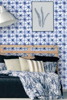 A contemporary Albany wallpaper design featuring a repeated geometric, diamond pattern.