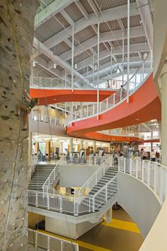 Auburn University recreation center - featuring 1/3-mile tiger-striped track that winds, inclines and loops around a rock climbing wall. Designed by 360 Architecture.