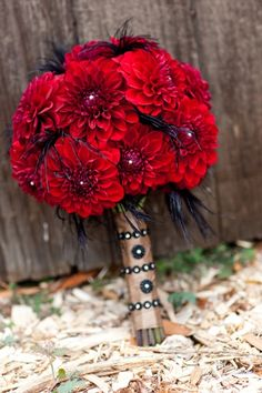 red bouquet with black feathers