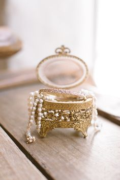 Showcase your wedding day jewels in a lovely vintage jewelry box! Dig around and you may be lucky to find a gorgeous familly heirloom just like this one!