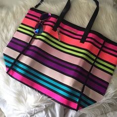 Victoria's Secret tote neon striped beach bag Love their new tote. And the colors are amazingggg!! Huge tote! Brand spankin new! Victoria's Secret Bags Totes
