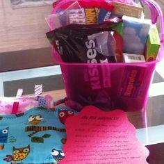 New mom survival kit :) kisses, mirror, Hair elastics, Life savors, tissues, eraser, starbursts, sour patch kids, advil, cozy socks