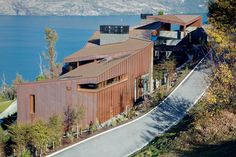 The layered, multifacted configuration of this house by architect Anna-Marie Chin forms a distinct silhouette. Copper House, New Zealand Houses, Residential Architecture, House Architecture, Large Homes, Cladding, Exterior, Cabin, Mansions