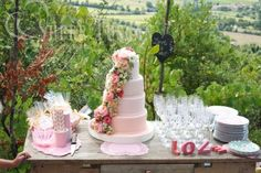 Wedding Country Chic Style: Vineyard landscape for this table with wedding cake, sweets and dinner set www.supertuscanweddingplanners.com