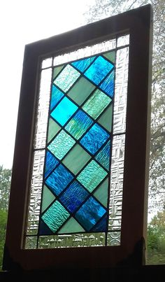 Beach house stained glass panel, framed in aspen. Measures 19'' x 11'' by Birosglass on Etsy https://www.etsy.com/listing/540458432/beach-house-stained-glass-panel-framed