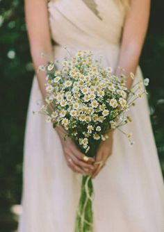 A charming little chamomile bouquet is very traditional. Chamomile symbolizes patience and is said to attract wealth!