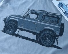 Land Rover Defender 90 T-shirt by with art by Stuart Macey. Inspired by the Willys the Land Rover was first developed by chief designer Maurice Wilks as a farm work truck in Wales in 1947. The Land Ro
