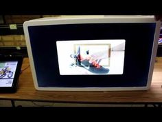 Planar transparent LCD screen showing off nike shoes - YouTube