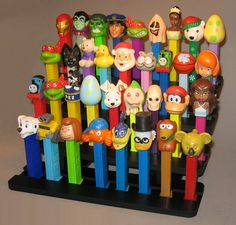 Attractive formation of Pez candy dispensers, displayed in a unique stand.