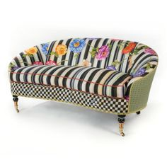 We know spring has sprung when our vibrantly colored gardens begin to blossom. Our Cutting Garden Loveseat is inspired by our lovingly tended flowerbeds, and designed by the artisans whose studio windows look out over the grounds. With a frame crafted of domestic hardwood and cotton-linen fabric featuring oversized blooms strewn across a swath of Courtly Stripes, this exuberant loveseat heralds a fresh season here at MacKenzie-Childs.