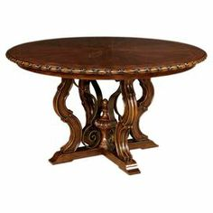 "Ornate round dining table with a pedestal base and inlay top.  Product: Dining tableConstruction Material: Poplar solids and knotty cherry veneersColor: Del MarDimensions: 30"" H x 58"" Diameter"