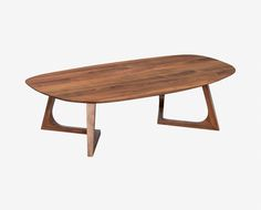 Dania - Crafted from solid American walnut, the Cress coffee table boasts an organically shaped tabletop supported by elegantly angled legs.