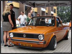 Girl posing with a Orange Volkswagen Caddy Pickup #babe #VW #Lady #Model #truck #pick-up #ute