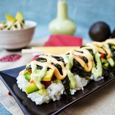 Lazy Sushi...seasoned sushi rice topped with your favorite sushi toppings and drizzled with spicy mayo sauce