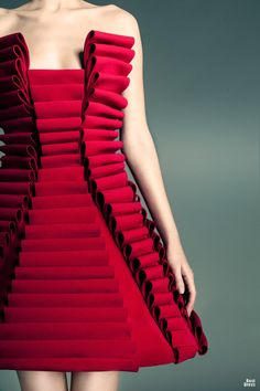 Fabric Manipulation for fashion - structured red dress with rolling pleats