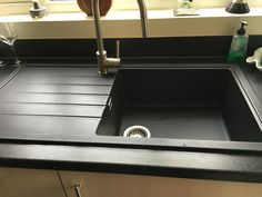 Customers picture of the Bluci Piazza PZ100LBG kitchen sink in black granite along with the Bluci Giona pull out single lever kitchen tap in a brushed finish.