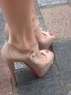 Nude shoes w/ red nails.