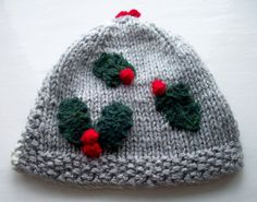 Four Seasons Tea Cosy Winter holly and the ivy unique fun knit by SpinningStreak This is a functional cozy to keep your tea hot for longer - great for taking outside.  This one - Winter - is another in the series of four one-off cosies representing the seasons. For the background snowy sky I used two strands of a variegated white to grey sparkly yarn to produce a thick but soft knitted fabric. You can almost feel the crunchy frost! The cosy is knitted in stocking stitch with garter stitch…