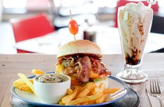 Today the Burger Bistro restaurant - which serves gourmet burgers and milkshakes and craft beer in a retro diner setting - has grown to four franchises. Bistro Restaurant, Burger Restaurant, Retro Diner, Gourmet Burgers, Restaurant Concept, Delicious Burgers, Craft Beer, Hamburger, Ethnic Recipes