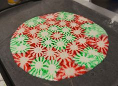 Homemade peppermint candy plate ~Homemade Candy Cookie Plate ~ Line a pizza pan with parchment paper and arrange mints. Bake at 350 for 8-10 minutes. Cool completely. This makes a perfect plate for giving cookies at Christmas without expecting the tray returned. So cool! You can even break it into pieces for the candy jar afterwards too!